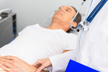 Physician taking pressure of serene client