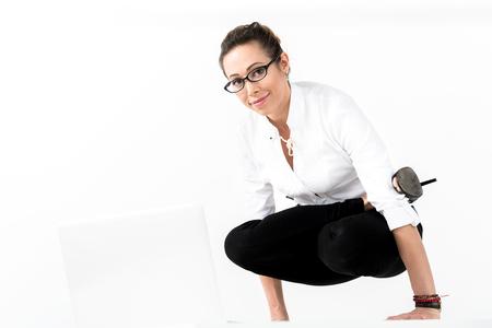 Outgoing female doing yoga gymnastics Stock Photo