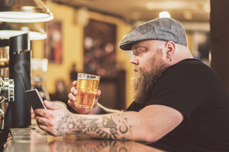 Thoughtful guy spending time in pub alone