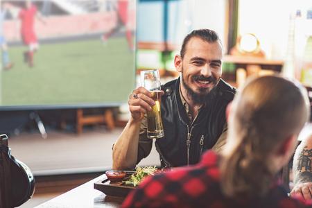 Cute guys enjoying light beer after work