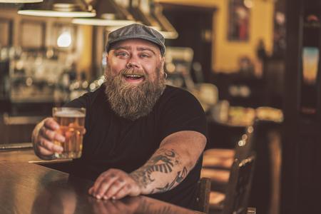 mirthful: Mirthful fat guy spending evening in pub