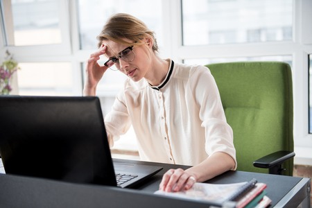Upset lady working in workplace