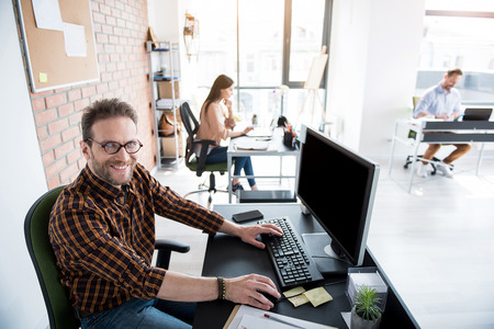 Happy smiling office worker in room Stock Photo