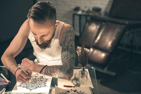Calm man painting picture in room Zdjęcie Seryjne