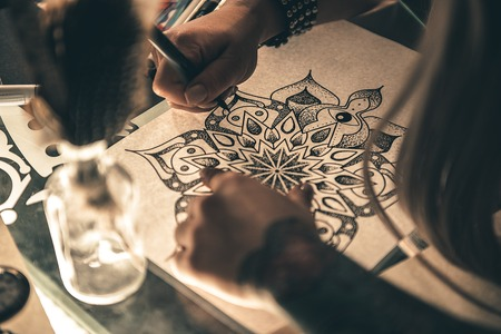 Woman designing picture at table