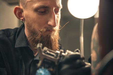 Pensive man making image on arm Banco de Imagens