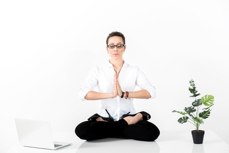 Serene woman making exercise during work