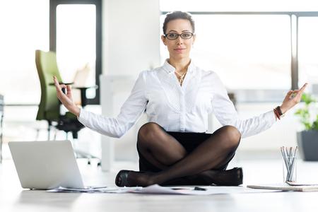 Serene female relaxing at office Stok Fotoğraf