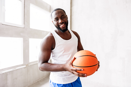 cheery: Cheerful bearded athlete training with ball