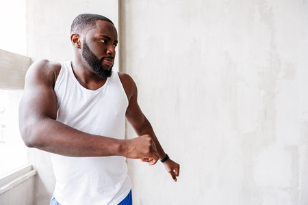 Pensive bearded african sportsman performing action Stock Photo
