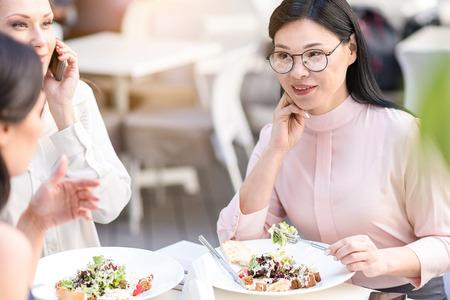 Happy businesswoman tasting in restaurant