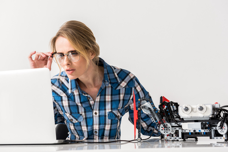 Discouraged young lady working on laptop Stock Photo
