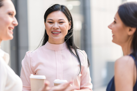 beaming: Beaming woman speaking with affiliates Stock Photo