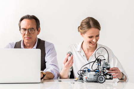 Pleasant professional colleagues are laboring together Stock Photo - 79319186