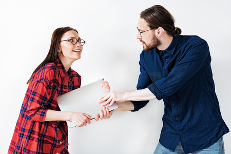 Couple is arguing about possession of modern computer Stock fotó - 79568025