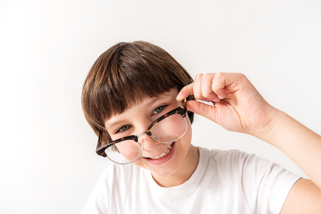 Happy smiling young male person keeping glasses