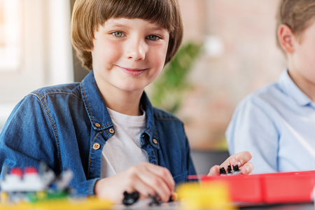 Happy smiling male child in workshop Stock Photo