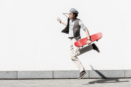 Active teenager is spending time on street dynamically