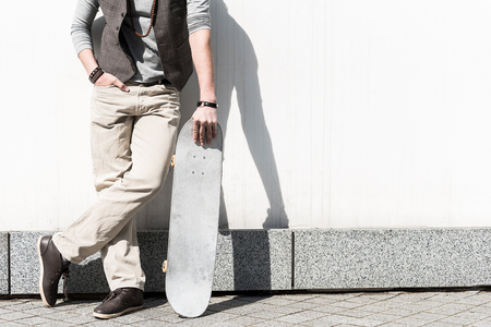 Stylish guy is standing outdoors