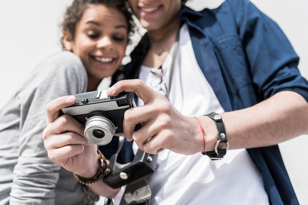 Pleasant young lovers enjoying their pictures Stock Photo