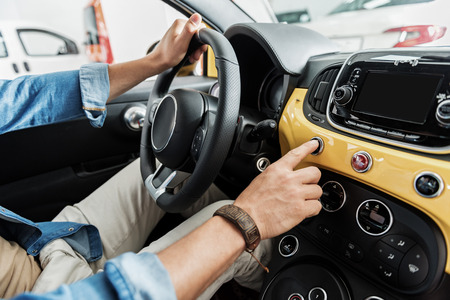 Male hand keeping helm in automobile Stock Photo