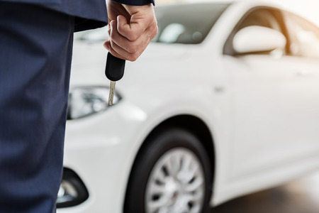 Male hand keeping car key Stock Photo