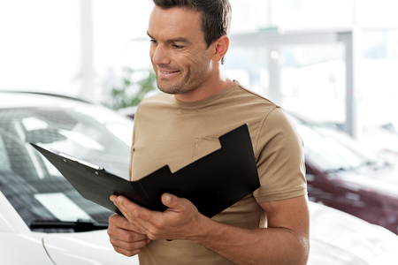luxury apartment: Cheerful man looking through document