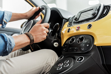 luxury apartment: Man arms holding rudder of car Stock Photo