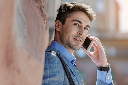 attentive: Interested young male person having conversation Stock Photo