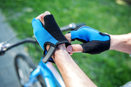 gear handle: Sporty male person getting ready for ride Stock Photo