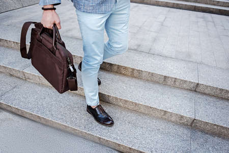Gent male person keeping handbag
