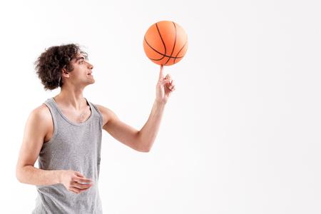 Cheerful skinny male basketball player