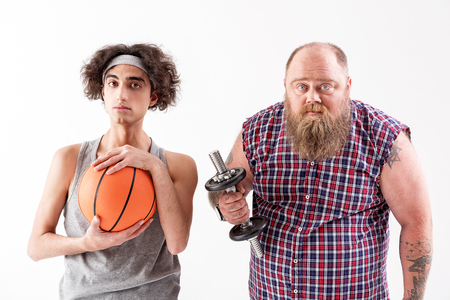 Thick bearded male hipster and thin boy