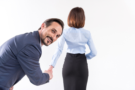 Pleasant mature male is standing with lady Stock Photo
