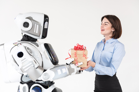 Cheerful girl is receiving present from boyfriend robot