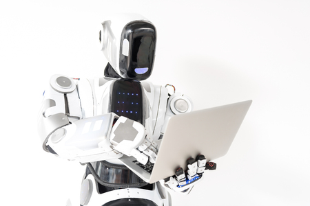 Modern robot is standing with notebook