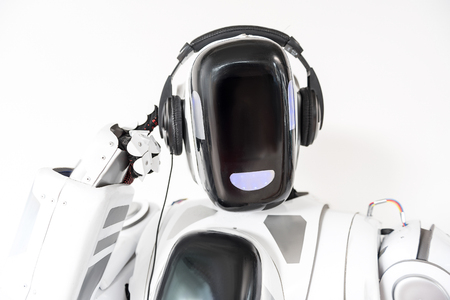 Pleasant big robot is wearing headphone