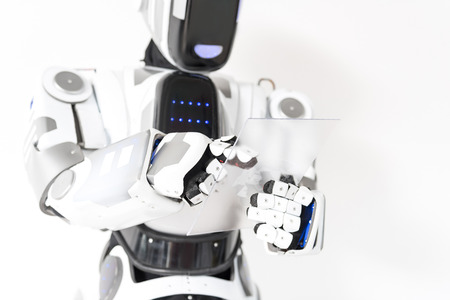 Positive robot is working with concentration