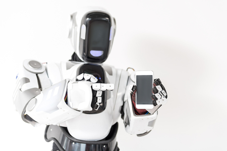 Pleasant robot is standing with smartphone Banco de Imagens