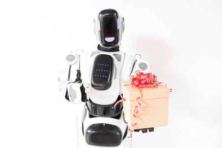 Happy robot is standing with gift box