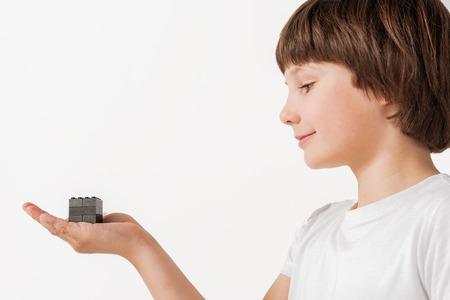Kindly smiling child presenting plaything Stockfoto
