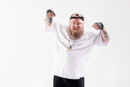 Irritated thick guy gesturing with aggression Reklamní fotografie - 80647760