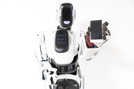 Smart robot is holding his gadget Фото со стока