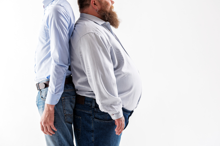 Slim and fat guys posing Stock Photo