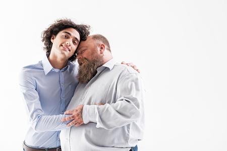 Joyful two loving couple of men embracing Imagens