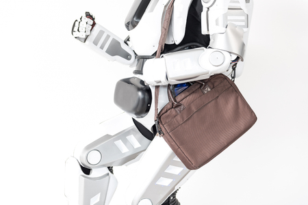 Modern robot is running with handbag