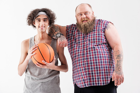 Joyful fat hipster and thin outcast are friends