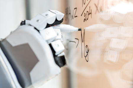 Smart droid making notes on transparent wall
