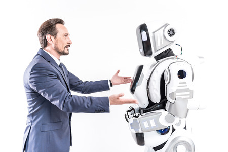 talking robot: Cheerful male person talking to smart machine