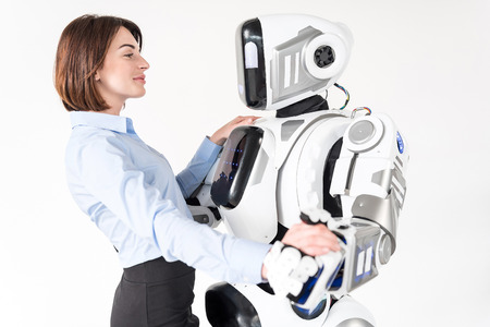 Modern cyborg and charming young woman hugging with tenderness
